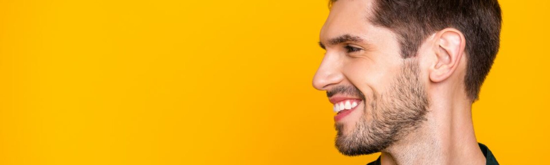 A happy male person, looking on the left side, header for tax advisor trainee