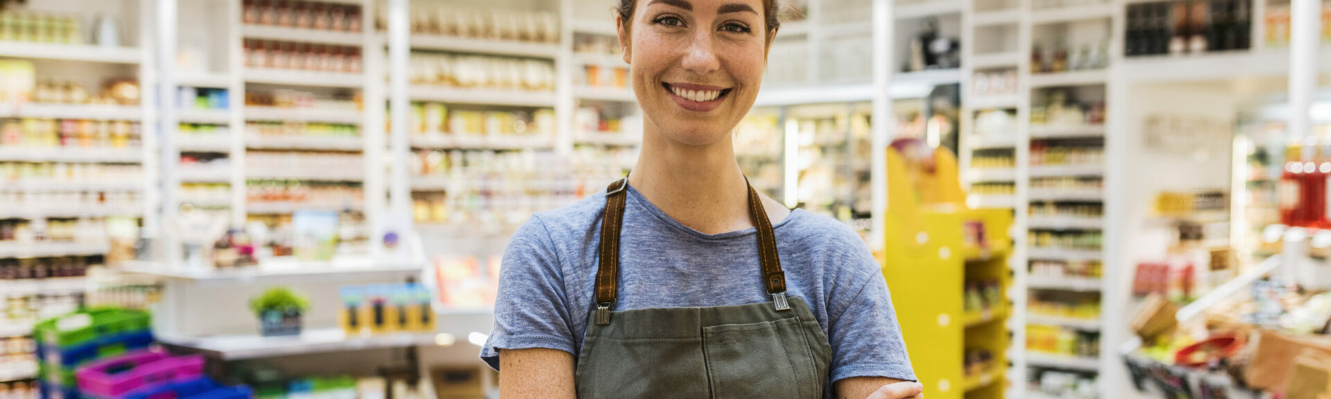A woman standing in a grocery shop
