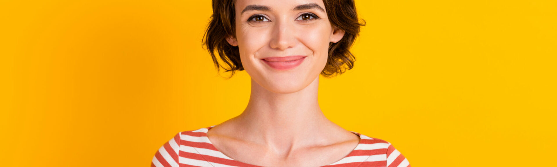 Close up portrait of satisfied gorgeous person smile look camera isolated on yellow color background
