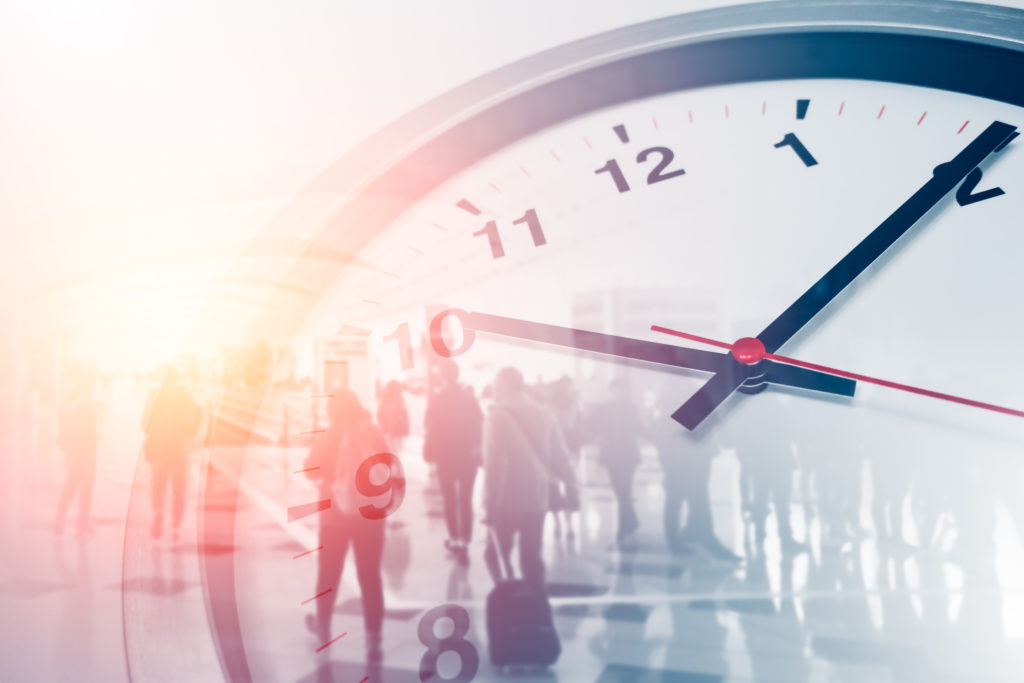 Business times concept people walking overlay with time clock